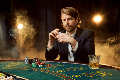 A young man struggling with a behavioral addiction like gambling.